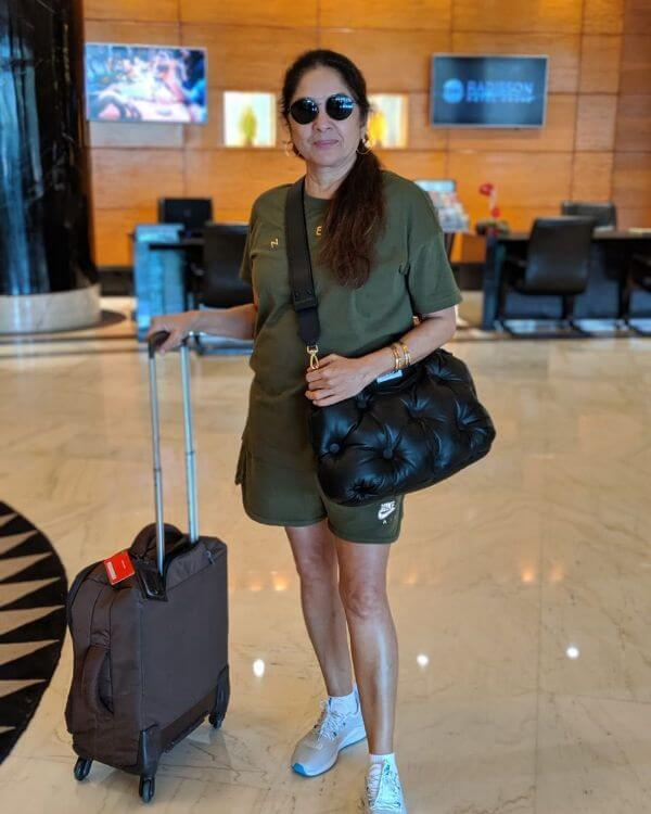 Neena Gupta olive green t-shirt and shorts with black side bag