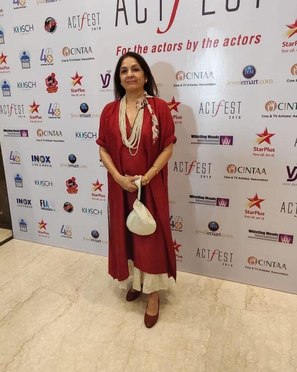 Neena gupta maroon kurta with off-white palazzo with white pearl necklace for casual or festive look