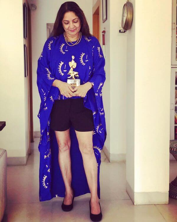 Neena gupta dark blue high low top with black shorts for casual look