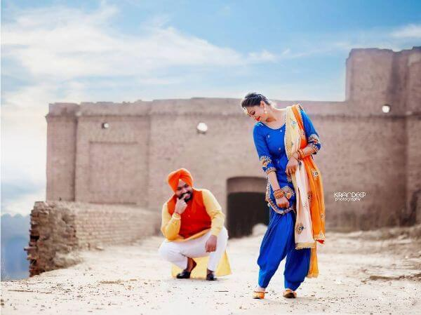 Navy blue salwar suit with orange dupatta for any occasion