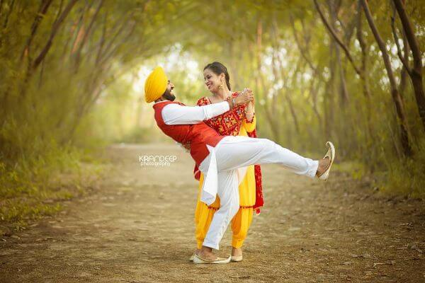 Yellow suit with red dupatta combination, with men's white kurta set and yellow turban