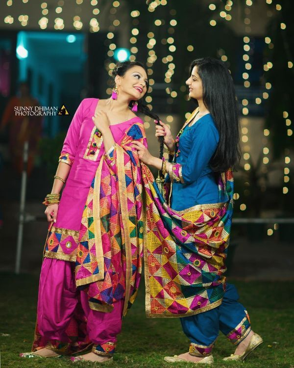 Pink and blue salwar suit , accessorised with juttis and heavy dupattas