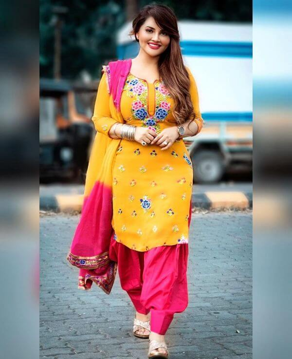 Khushi Gadhvi looks beautiful in her yellow suit accessorised with a watch and bangles other hand with a nice pair of heels.