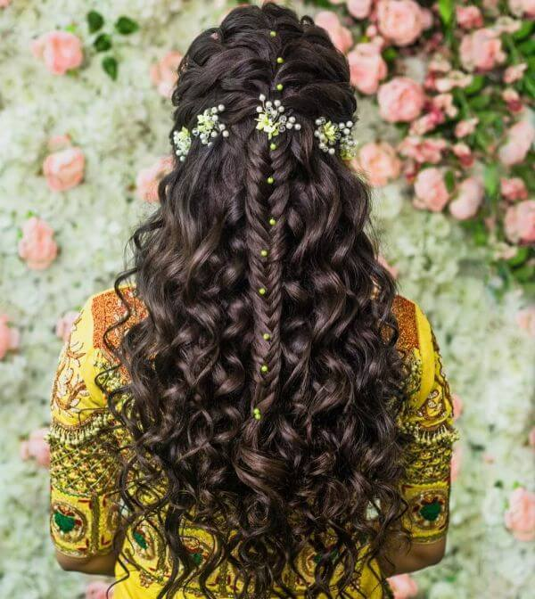 Loose curls and half hair braids with hair accessories perfect for haldi function