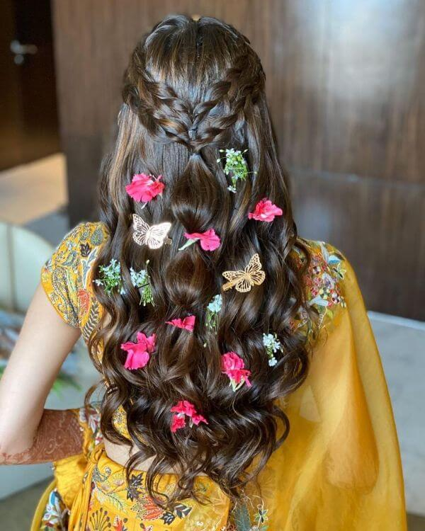 Braids over the crown area with butterfly and flower accessories over the hair looks - Bridal Hairstyle Ideas for Haldi Function