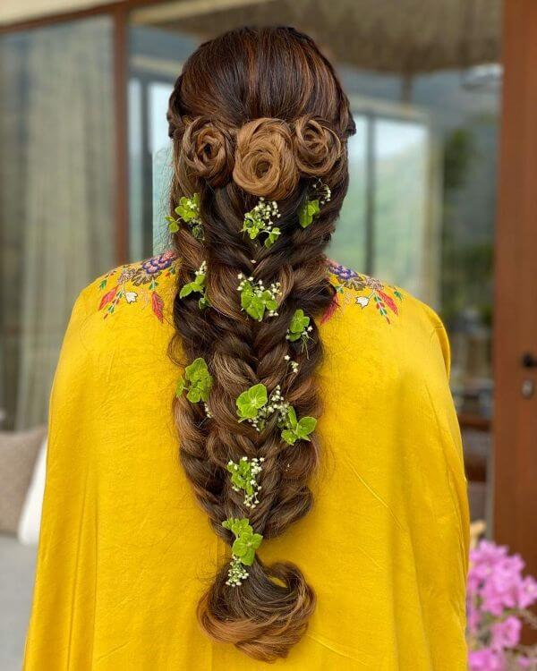 Three twisted buns with forest green florals and tiny baby breaths hairstyle - Bridal Hairstyle Ideas for Haldi Function