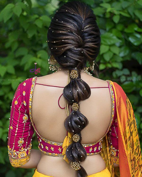 Bubble braided-hairstyle with dainty stone embellishments scattered randomly hairstyle - Bridal Hairstyle Ideas for Haldi Function