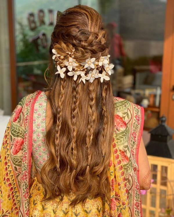 Crown braid with flower accessories and giving it a waterfall look hairstyle for festive season