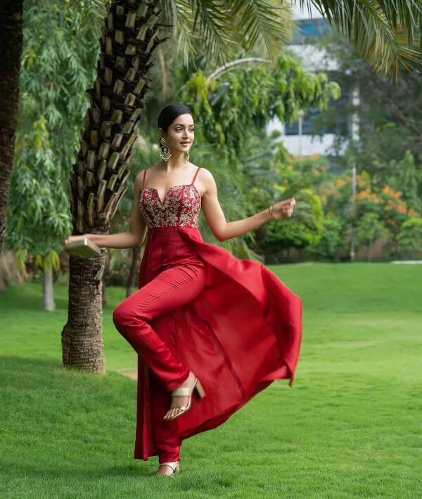 The bright red jumpsuit style bridesmaid outfit Shanvi Srivastava Bridesmaids Outfits | Trending This Year