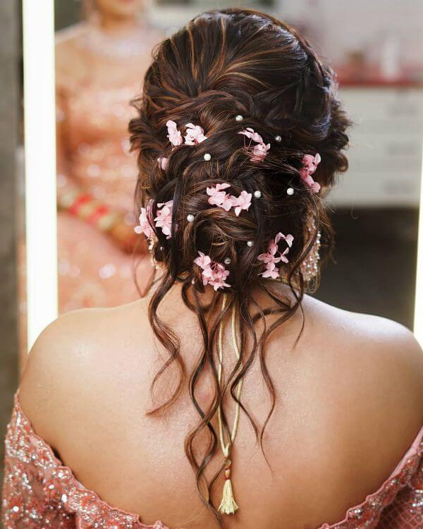 Messy bun with pink hair accessories gorgeous hairstyle ideas for brides and bridesmaids