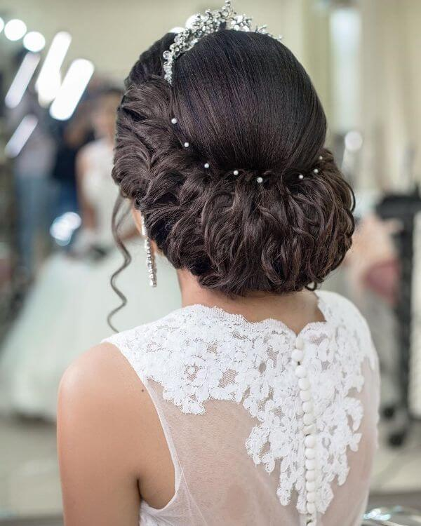 Queen bun hairstyle with silver headpiece for your wedding