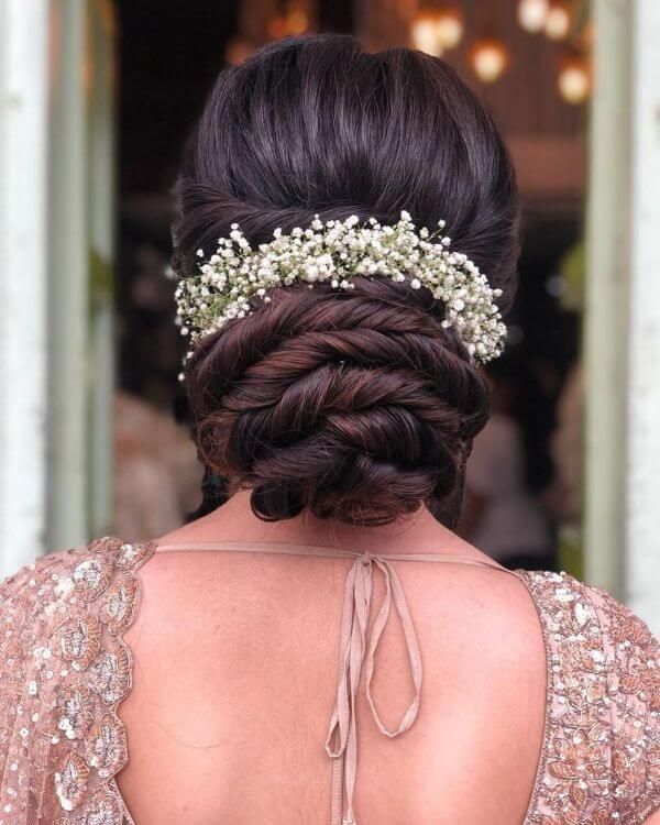 Rose twisted bun with flower hair accessories for bride and bridesmaids