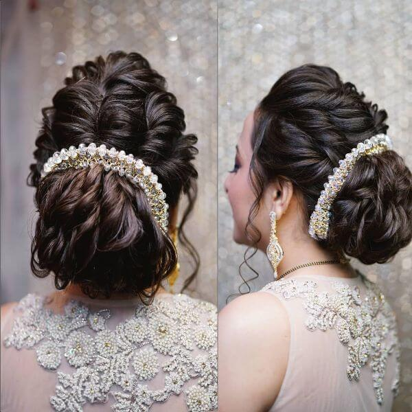 Multiple twisted messy bun with heavily jewelled crown hairstyle