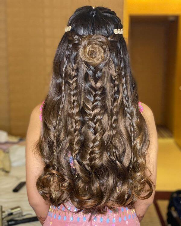 Open hair with multiple braids and a rose on the top for small functions Indian Bridal Hairstyles For Sangeet