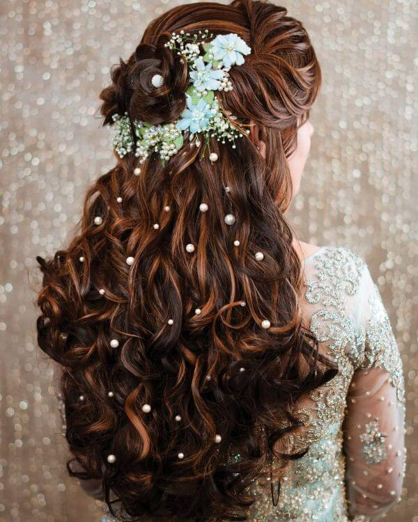 Semi-open hair with ringlet curls and breath flowers for both summer & winter wedding