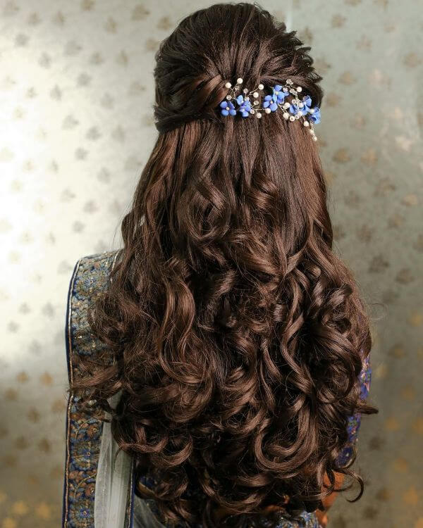 Long hard crunchy curls & blue and white hair accessories Indian Bridal Hairstyles For Sangeet