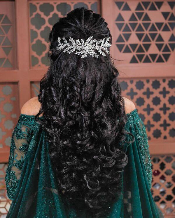 Long black curls & hair accessories Indian Bridal Hairstyles For Sangeet