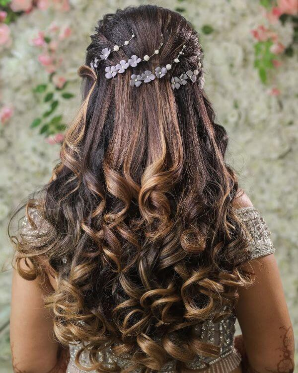 Long tresses with twisted bouncy curls & hair accessories for small occasion