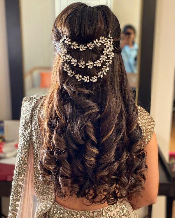Long tresses with twisted curls & hair accessories for sangeet ceremony