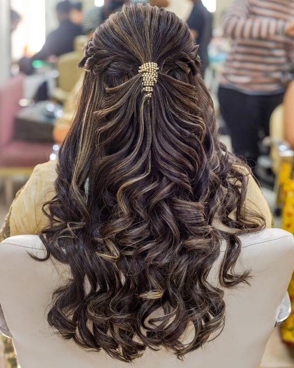 Long tresses with twisted curls & hair accessories Indian Bridal Hairstyles For Sangeet