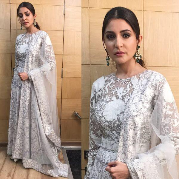 Anushka Sharma looks resplendent in a white and silver lace embroidery anarkali suit from Manish Malhotra,she looked nice.