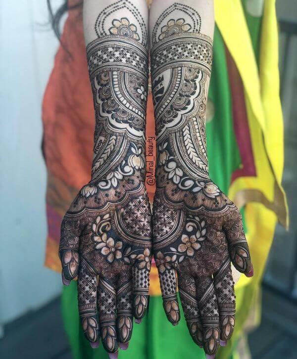 Multiple floral mehndi design for full hands Symmetrical Bridal Full Hand Mehndi Designs
