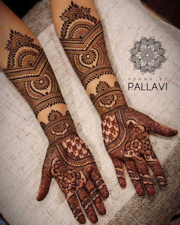 Dark and light blend mehndi design for full hands Symmetrical Bridal Full Hand Mehndi Designs