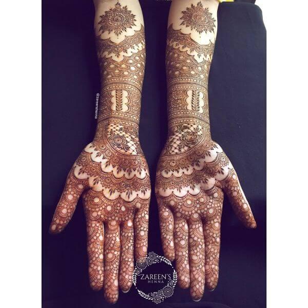 Complicated pattern mehndi design for full hands Symmetrical Bridal Full Hand Mehndi Designs