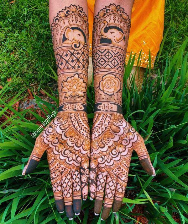 Elephant and lotus mehndi design for full hands Symmetrical Bridal Full Hand Mehndi Designs