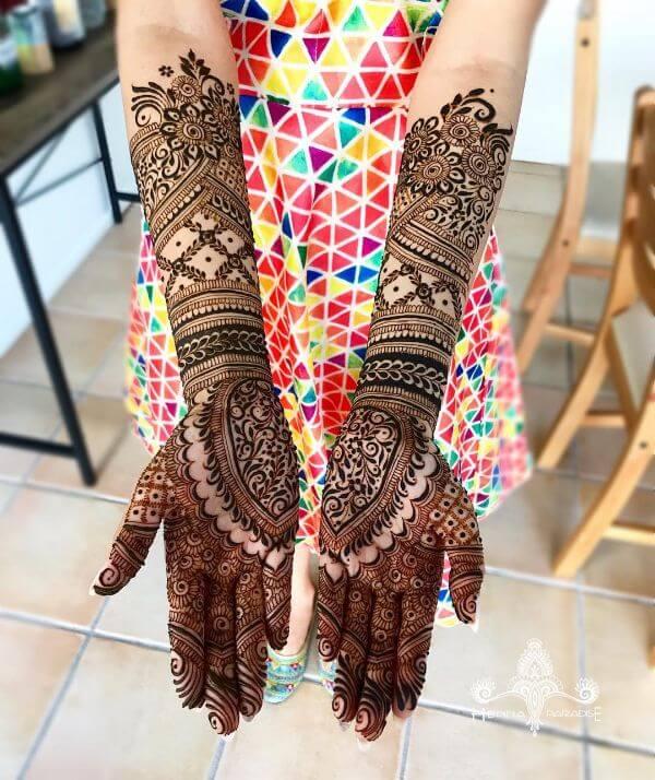 Floral mehndi design for full hands Symmetrical Bridal Full Hand Mehndi Designs