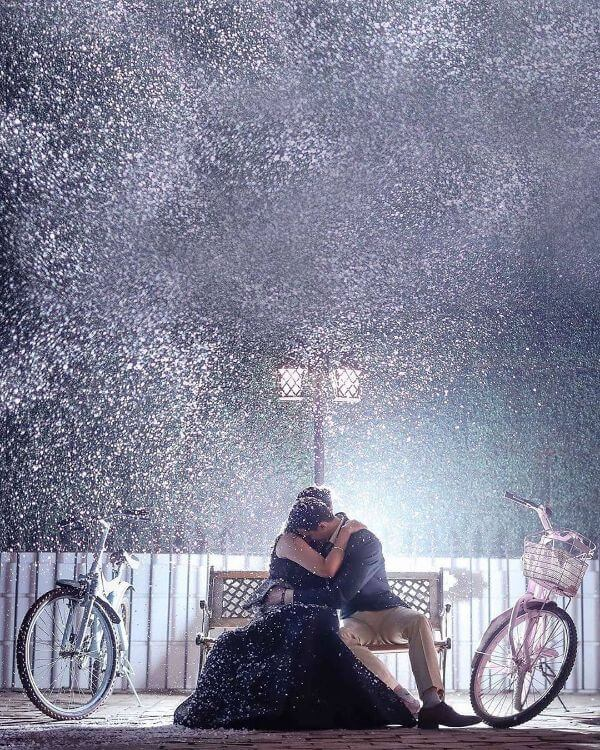Pre-wedding shoot of shower of snow Winter Pre-Wedding Photoshoot Ideas with Beautiful Locations