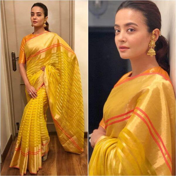 Surveen Chawla fabulous yellow saree with gold earrings for any occasion