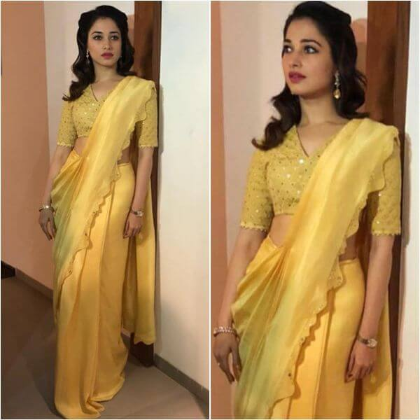 Tamanna fancy yellow saree with v neck blouse for any occasion