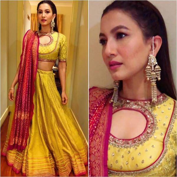Gauhar khan opted a yellow lehenga choli that flares out to the bottom with pink dupatta