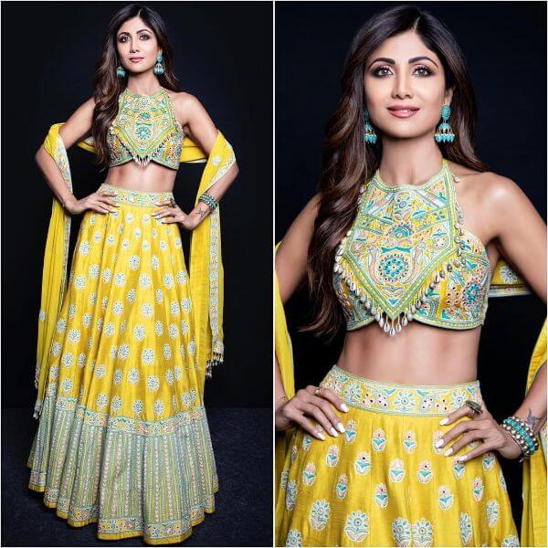 Shilpa Shetty's yellow halter-neck multi hued flower embroidered lehenga with matching multi-hue yellow dupatta