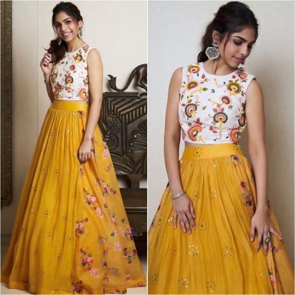Sharmin Segalsimple & elegant yellow lehenga skirt with white crop-top