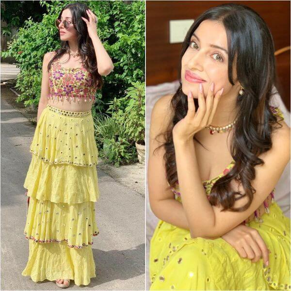 Divya Khosla donned a lemon yellow multi layered lehenga with multi color flower embroidered crop-top