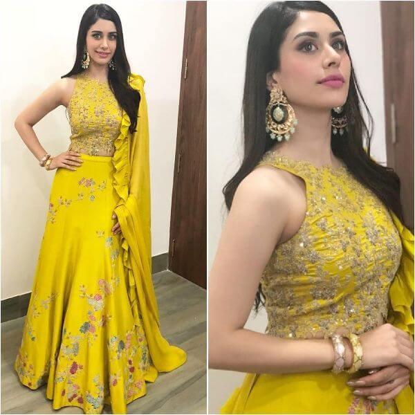 Warina Hussain in her yellow zero halter neck blouse and flower embroidered lehenga choli