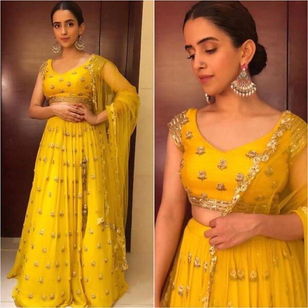 Sanya Malhotra's yellow lehenga, paired with multi colour jhumkas