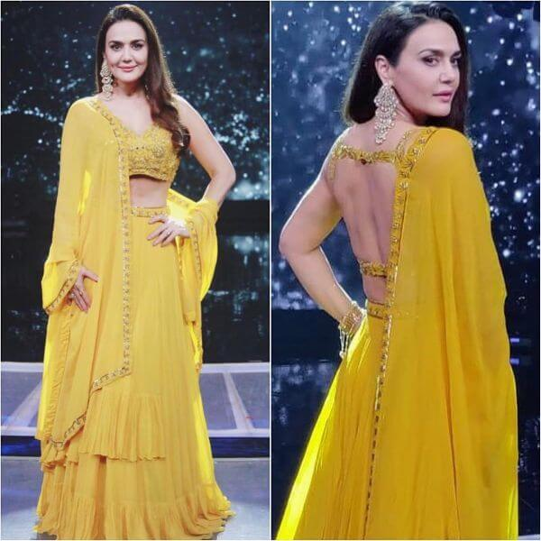 Preity zinta's deep square cut-out blouse with gold embellishments and bright yellow lehenga choli