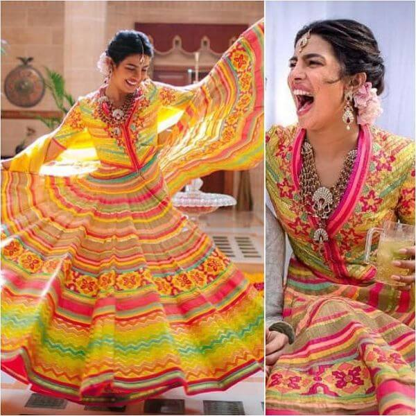 Priyanka chopra's lehenga featured right shades of yellow, pink and green with flared choli