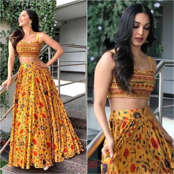 Kiara Advani's yellow floral prink skirt with red, blue and green shades and strapped crop-top