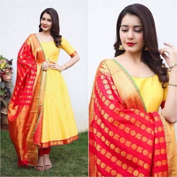 Plain yellow anarkali suit paired with contrast red kanjeevaram silk dupatta