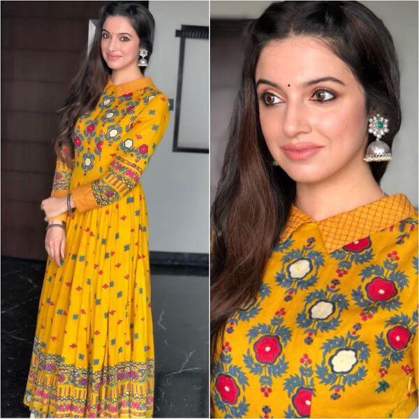 Yellow printed floor length attire with bit of red,grey and white prints