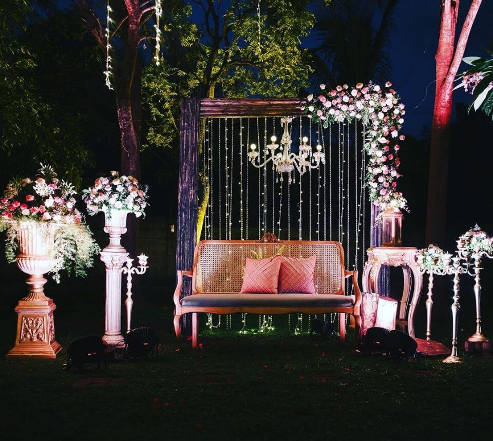 Chandelier and falling light backdrop wedding chair