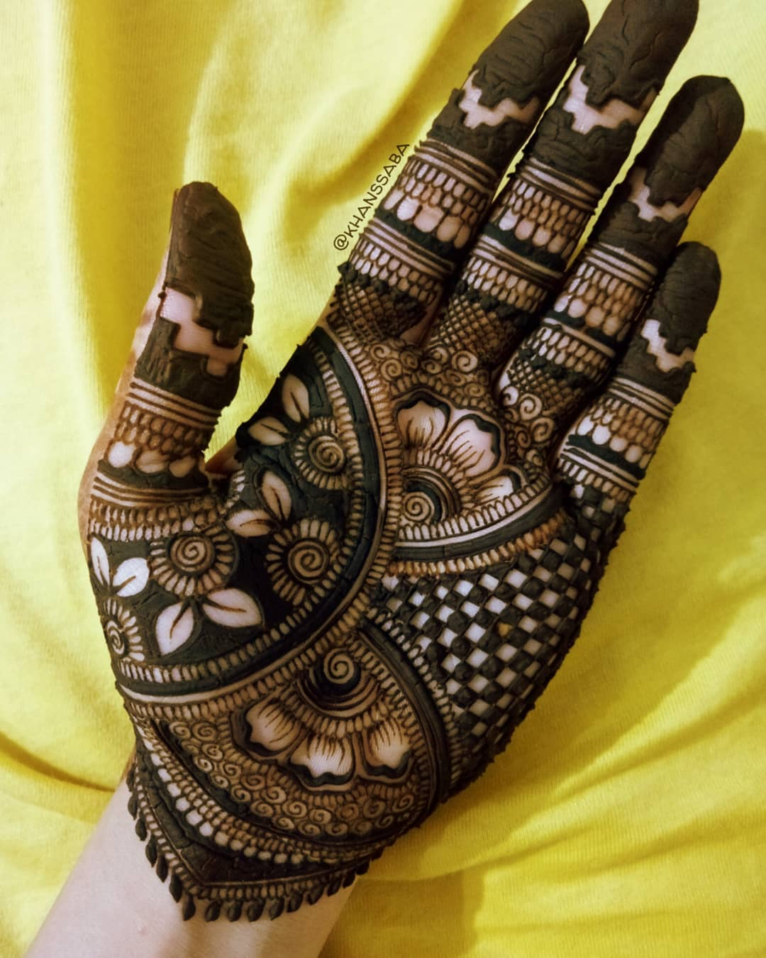 Floral and checked palm mehndi designs for full hand