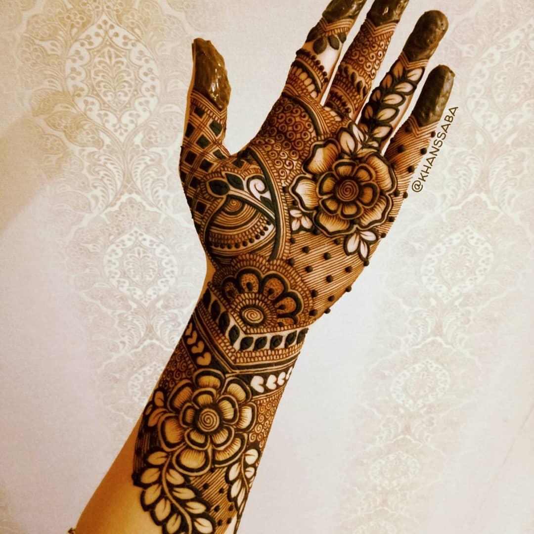 Floral charm mehndi design for full hand