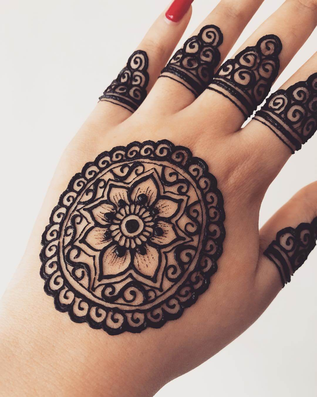 Spiral mandala mehndi design for back hands