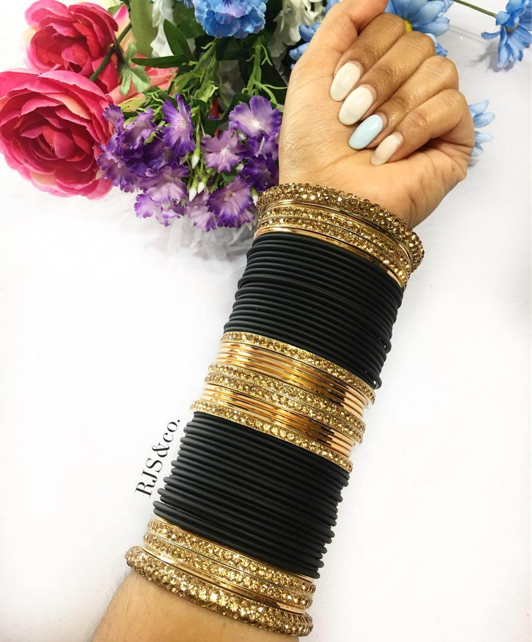 Black and gold bridal bangle design Heavy Metal Bridal Bangle Designs