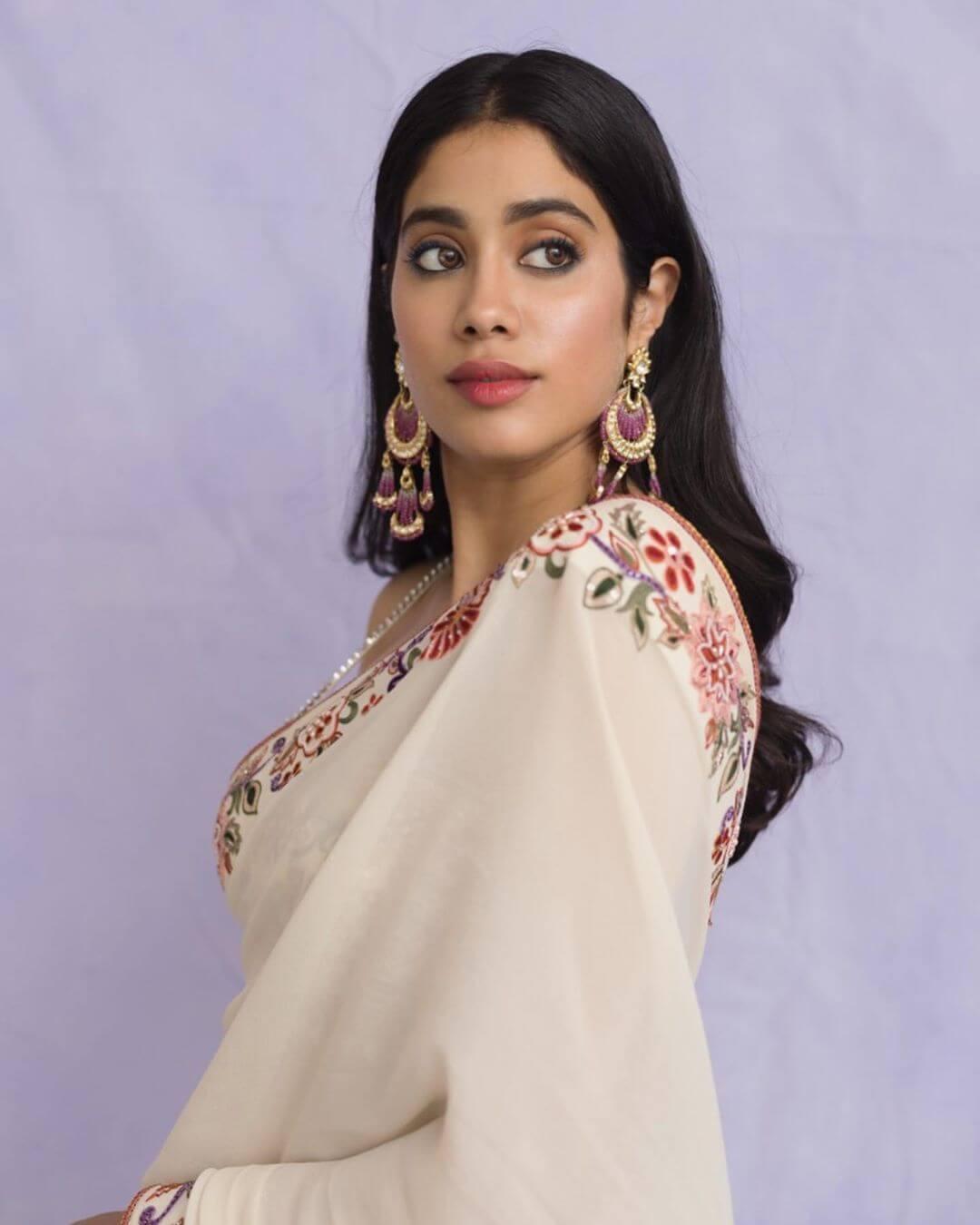 The chandelier gold and polki earringsDangler ruby traditional earrings Janhvi Kapoor's earrings